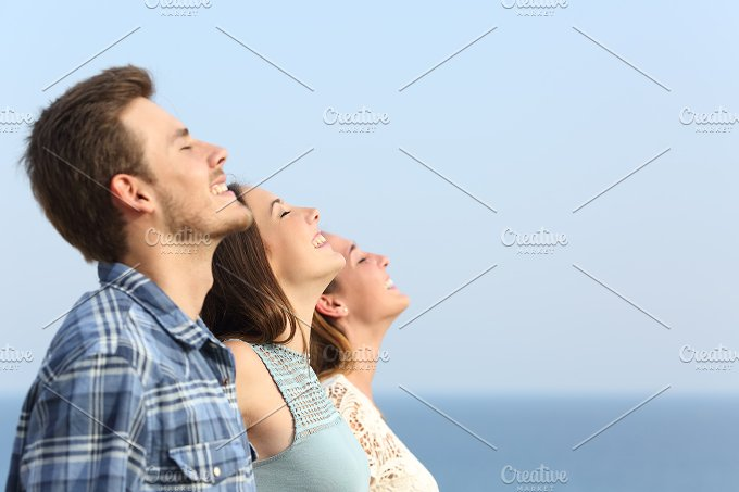 Group of friends breathing deep fresh air.jpg - Health