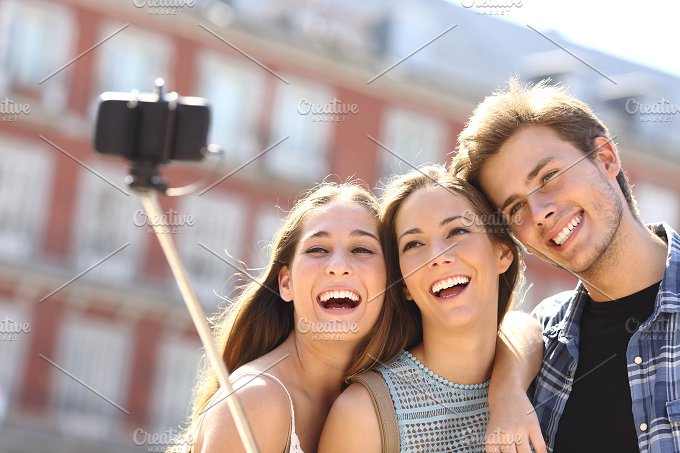 Group of tourist friends taking selfie with smart phone.jpg - Technology