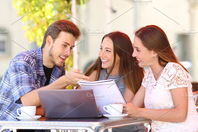 Three students studying and learning in a coffee shop.jpg - Education