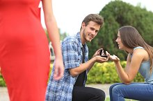 Unfaithful man looking another girl during proposal.jpg