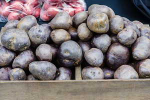 Dark blue potatoes at market