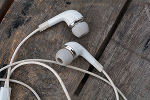 Ear Phones on Wooden Table