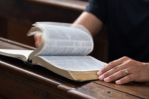 Reading Bible in the church