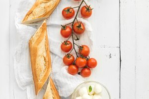 Baguette with banch of tomatoes