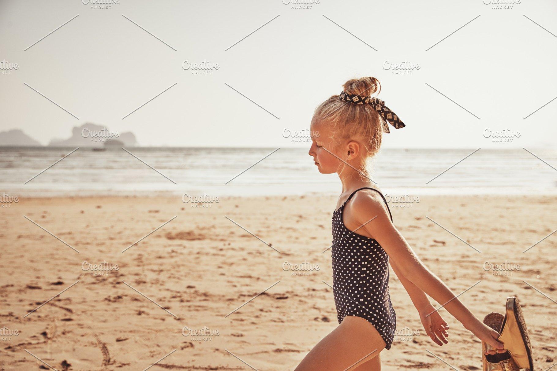 10461a1a45 Cute little girl walking on a beach ~ People Photos ~ Creative Market