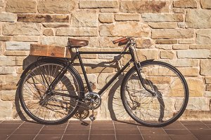 Vintage bike on a stone wall
