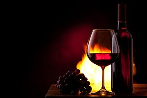 Wine, grapes and fire.