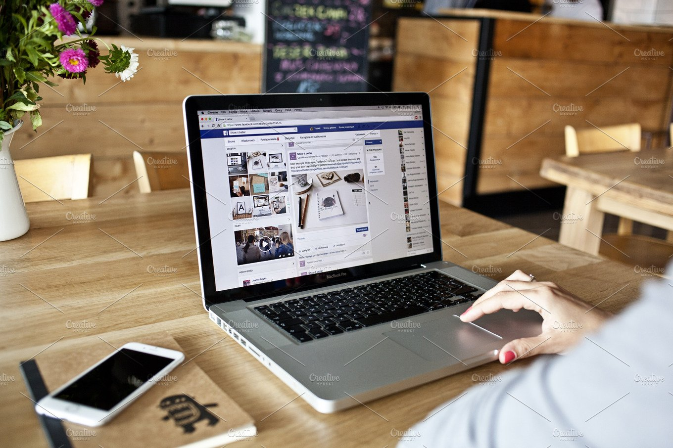 macbook pro in a bistro cafe photo business photos creative market. Black Bedroom Furniture Sets. Home Design Ideas