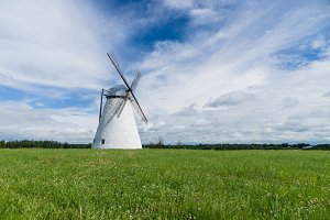 Large windmill in a grass field
