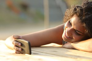 Girl watching videos or social media in a smart phone.jpg