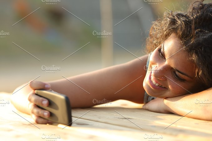Girl watching videos or social media in a smart phone.jpg - Technology