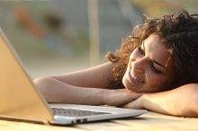 Woman watching media in a laptop.jpg