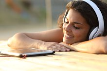 Woman listening to music from a tablet.jpg
