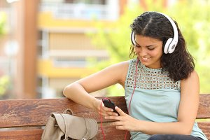Woman listening to the music in a park.jpg