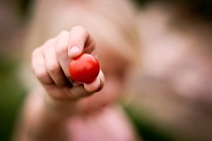 Child with Cherry Tomato