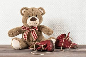 Teddy bear and baby shoes