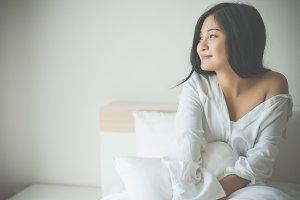 Beautiful young woman wake up
