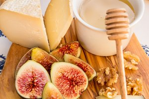 Cheese, honey, figs, nuts, grapes