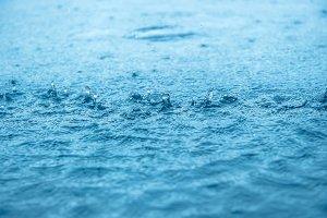 Blue water splash with rain drops