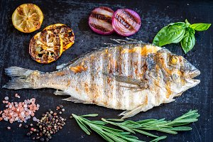 Grilled dorada fish fresh vegetables