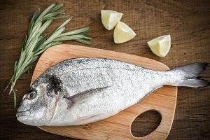 Fresh dorada with ingredients