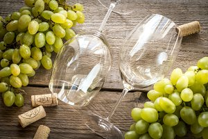 Glasses of white wine with grape