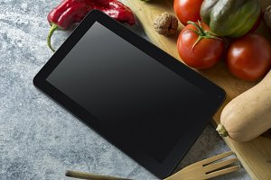 Menu Digital tablet with fresh veget