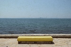 Bench on blue sea background