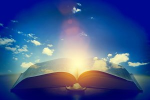 Open old book in the sunlight