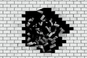 White brick wall falling down