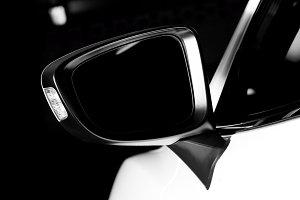 Luxury car wing mirror close-up