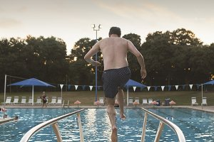 Man Jumping off Diving Board