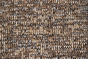 knitted brown canvas grunge texture as background