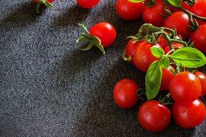 bunch of fresh organic cherry tomatoes on  dark background.