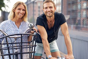 Fit young couple out biking