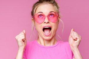 Portrait of cheerful blonde in pink