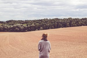 Girl walking in a field