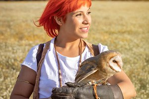 Red hair woman with a white owl on h