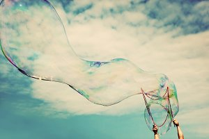 Blowing big soap bubbles in the air