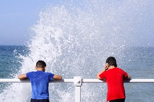 Children playing in the waves.