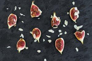 Fresh cutted figs on a dark stone