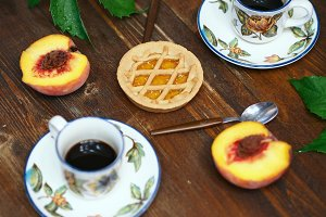 Coffee and peaches still life