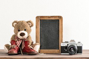 Teddy bear with chalkboard