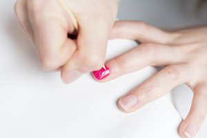 Closeup of Woman applying nail varni