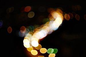 natural lens blurred color bokeh on dark nightlife of city background