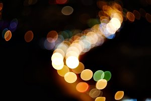 natural lens blurred color bokeh on dark nightlife of city background