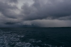 Dark Clouds over Ocean Waves