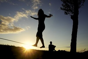 woman balancing in slack line