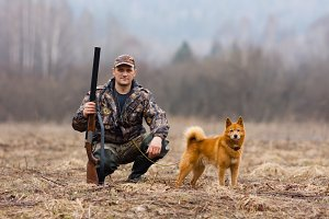 hunter with a dog on the field