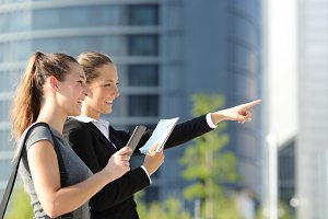 Businesswomen searching location with mobile gps and map.jpg